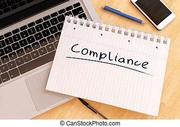 Compliance - handwritten text in a notebook on a desk - 3d...