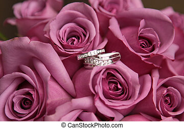 Wedding Flowers - Wedding rings in a bouquet of pink roses.