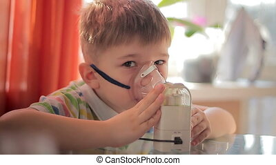 Child with inhaler 6 - The little boy makes treatment...