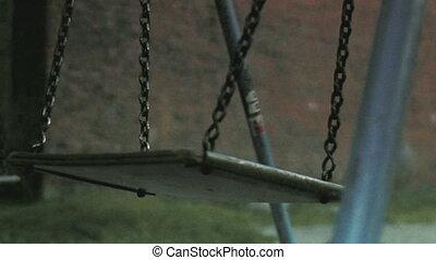 deserted old swing