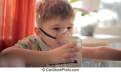 Child with inhaler 7 - The little boy makes treatment...