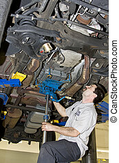 Mechanic working - Mechanic setting up jack transmission...