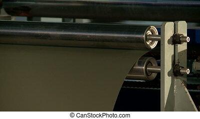 View of metal sheet passes through rollers - Metal sheet...