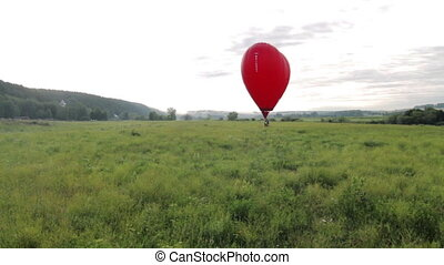 Flight of behind hot air balloon in shape of heart