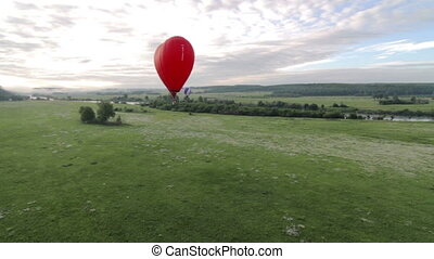 Aerial view of hot air balloon in shape of heart - Flight of...