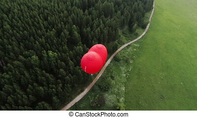 Flight of behind hot air balloon in shape of heart - Flight...