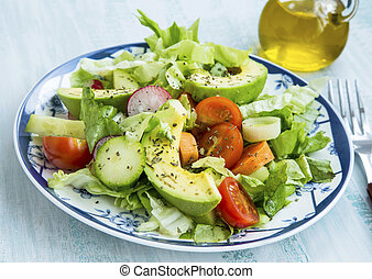 Salad with avocado,lettuce,tomatoes,radish,onions and spices