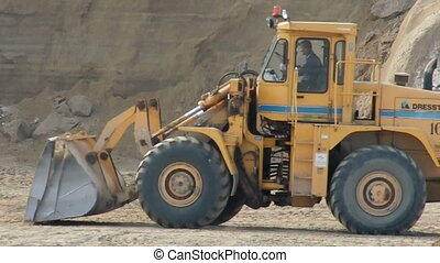 dig tractor   - quarrying sand at pit near Moscow