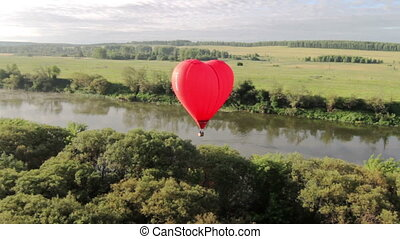 Aerial view of hot air balloon over the river - Flight of...