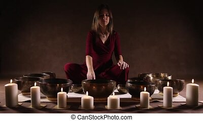Young woman playing Tibetan bowls - Young woman relaxing...