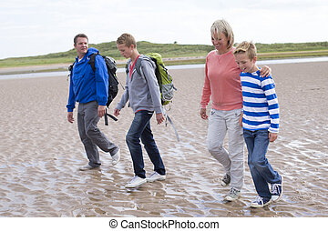 Ready for our walk - Family of four walking across the...