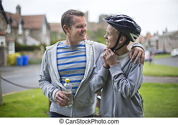 Father and Son getting ready for their bike ride. The father...
