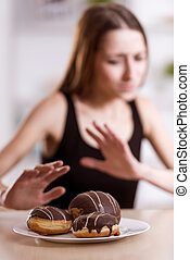 She refuses to eat - Thin girl refuses sweets that are in...