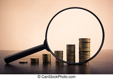 Banking. Go to Bank. Golden columns of coins on white background. Toned picture