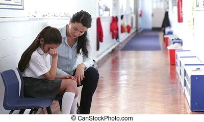 Supportive Teacher - A teacher offers support as a young...