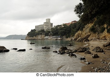 View of Lerici Castle from the beach in Liguria, Italy.