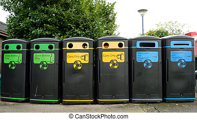 Recycling bins in a row - Group of various recycling bins in...