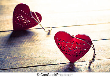 Heart on a wooden background. Rustic style.