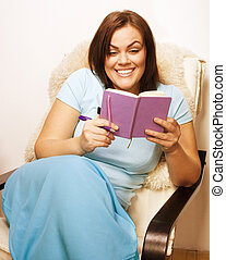 big pretty young woman at home resting, reading book,...