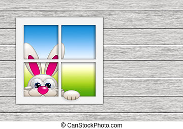 easter bunny looking by the window with place for text