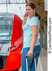 brunette woman embarks on a journey by train