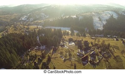 Aerial shot of village in the Carpathian mountains at spring...