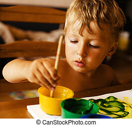 portrait of little boy painting at home interior close up -...
