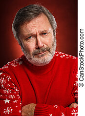 Portrait of a sad man in a red sweater on a red  background