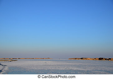 frozen lake with blue sky
