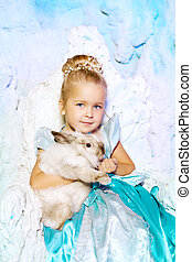 Little girl in princess dress on a background of a winter...