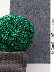 Artificial boxwood ball - One artificial boxwood ball in a...