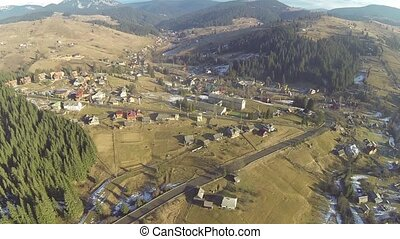Aerial shot of village in the Carpathian mountains at spring