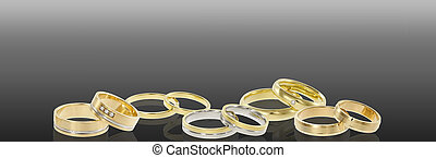 Group of wedding rings - Banner wedding ring on a gray...