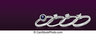 Diamond and sapphire rings on purple background
