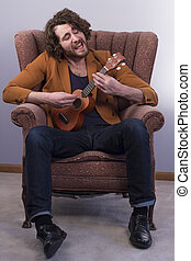 Musician Playing Acoustic Ukulele - Bearded musician playing...