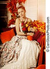 Young beautiful woman in vintage dr
