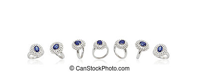 Gold ring with sapphire on white background - Banner with...