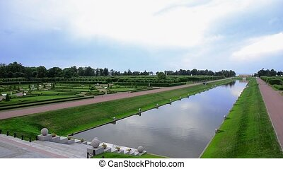 Beautyful summer Petergof with fouintains.  Water channel in middle of a park.