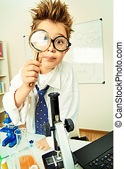 magnifying glass - A boy concentrated working in the...