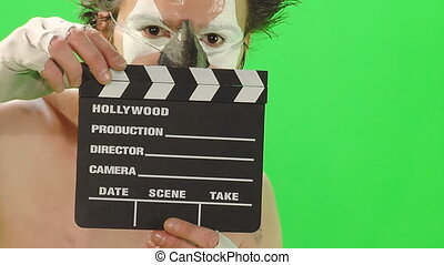 Clown with small cinema clapboard