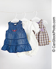 Children clothes on racks - Children clothes hanging up on...