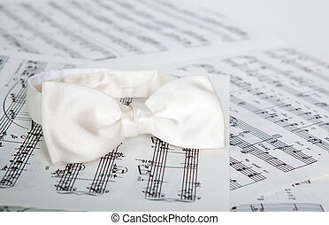 Music objects - White silk bow-tie on printed music sheets