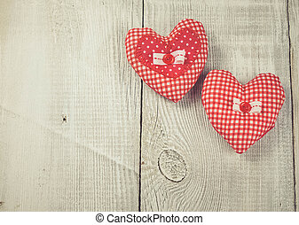 Two hearts hanging on wooden background - Two Handmade...