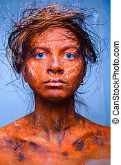 woman with a red face, body art