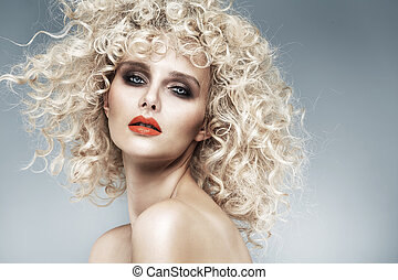 Beautiful blonde with a quaint curly haircut - Beautiful...