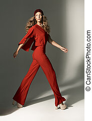 Fashion photo of young woman wearing red suit - Fashion...
