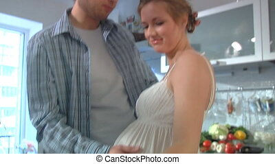 expectant parents 5 - Young expectant parents in home...