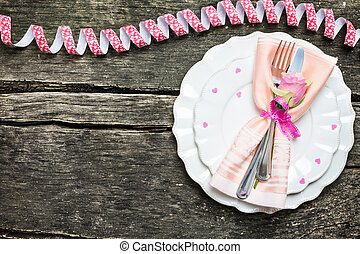 Place setting for Valentine's Day on wooden