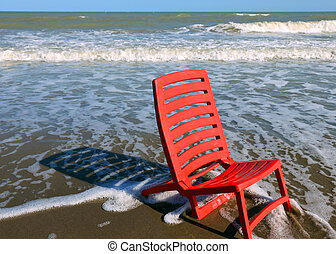 red beach chair by the ocean - little red beach chair by the...