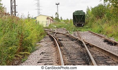 View of abandoned old railways in summer windy day. An old...